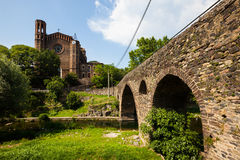 Church and medieval bridge in Sant Joan les Fonts. Ancient church and medieval bridge, built with volcanic stone in Sant Joan les Fonts. Catalonia Royalty Free Stock Photo