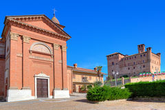 Church and medieval castle in small italian town. Royalty Free Stock Photography