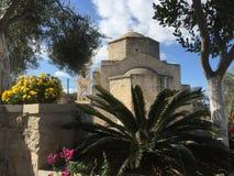 The church in the Mediterranean garden. Cyprus garden by a church 2016 Royalty Free Stock Photography