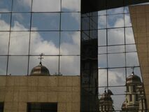 church-mirroring-on-office-building Royalty Free Stock Photo