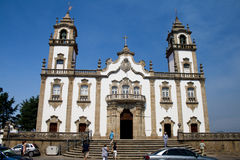 Church of Misericordia in Viseu. VISEU, PORTUGAL August 11, 2015: People going to the Misericordia church service in the central square, near of cathedral royalty free stock photo