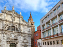 Church and modern building in Venice, Italy. Royalty Free Stock Images