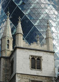 Church with modern office in background. Old church in foreground, modern office in background, London Stock Images