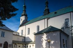 Convent buildings in Radomsko city in central Poland. Church and Monastery of the Franciscan Fathers in Radomsko, Poland Stock Photography