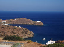 Church monastery on promontory in Aegean Sea with houses and boa. T Sifnos Greek Island Cyclades in Greece Stock Photography