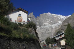 The church and Mont Blanc Stock Photography