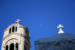 Church and monument with the moon in the background.  Royalty Free Stock Photos