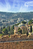 The Church. The morning sun illuminates the dome. The Church  in Jerusalem. Battlements of Jerusalem surrounded by majestic building.  On the wall is fenced path Stock Photo