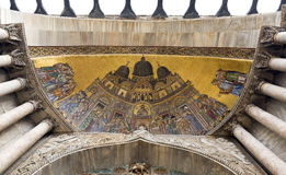 Church Mosaic on San Marco. A golden mosaic inlaid on an entryway into San Marco Basilica in Venice, Italy Stock Photo