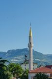 Church and a mosque in mountains.  Royalty Free Stock Photo