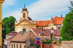 Church of the Most Sacred Heart of Our Lord and the Ursuline Convent behind the rooftops in Kutna Hora, Czech Republic. Stock Photos