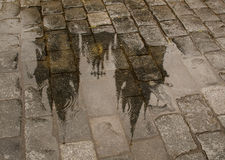 Church of Mother of God before Týn roof reflection in puddle Stock Images