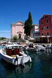 Church and motor boats in Veli Losinj island in Croatia Stock Photo
