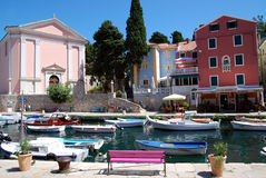 Church and motor boats in Veli Losinj island in Croatia Royalty Free Stock Image