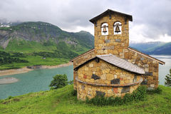 Church on the mountain lake shore. French Alps: сhurch on the mountain lake shore Royalty Free Stock Photography