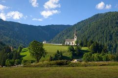 Church in the mountains. On a blue sky Stock Photography