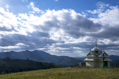 Church in the mountains under the blue sky Stock Images