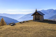Autumn landscape in Valtellina in Italy. Church on the mountains of Valtellina, Italy Royalty Free Stock Image