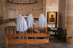 The Church of the Multiplication of the Loaves and the Fishes, Tabgha. View of praying nuns inside The Church of the Multiplication of the Loaves and the Fishes stock photos
