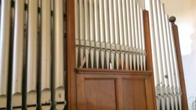 Church music organ with flutes on the wall