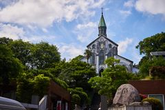 Church in Nagasaki, Japan. 。The sunny weather makes it look magnificent and tall。This church is very important in the religious history of Japan stock images