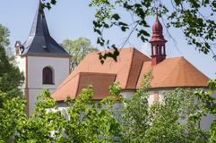 Church named Nanebevzeti panny Marie in Vraclav village, sacral historic heritage with tower nad red roof on the hill, blue sky. And sunlight Stock Photography