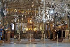 The church of the Nativity. The interior of the church of the Nativity during the Christian orthodox service, in Bethlehem, Israel. The site is traditionally stock photo
