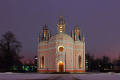 The Church of the Nativity of St. John Predtechi on a winter night. Russia, Saint-Petersburg, winter, night. Clouds and city illumination give the sky a pink Stock Photo