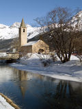 Church near a frozen river Royalty Free Stock Image