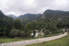 Church near mountain Stock Photo