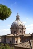 Church near ruins of Traian forum  in Rome Royalty Free Stock Photos