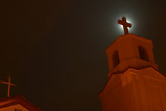 Church at Night. With cross silhouetted by the moon Royalty Free Stock Photo