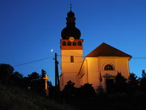Church at night. The moon and the church. Night illumination of buildings. cross, crucifix, the clock on the tower Stock Photo