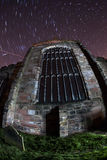 Church at night with star trails Royalty Free Stock Photo