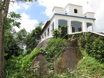 Church of Nossa Senhora da Penha - Paraty Paraty- Cunha. It is a church situated on a Big stone Stock Images