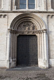 Church Notre Dame de la Chapelle in Brussels. Door of a church Notre Dame de la Chapelle in Brussels Stock Photo