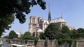 Church Notre Dame de Paris intact before the Fire. Curch Notre Dame de Paris intact with Crossing Tower before the Fire on the Ile de la Cite circa July 2013 in stock video footage