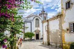 Church in Obidos, Portugal. On cloudy sky Stock Images