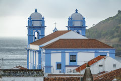Church and ocean in Angra do Heroismo, Island of Terceira, Azores. Long shot view of church in Angra do Heroismo with atlantic ocean in the background, Island of stock images