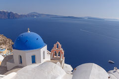 Church in Oia in front of caldera Stock Photo
