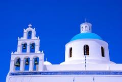 Church in Oia town on Santorini. Church on Santorini Island - Thira - Greece. Oia town, blue sky, white church and bells tower Stock Photography
