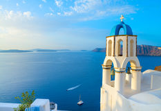 Church in Oia with traditional belfry, Santorini, Greece Royalty Free Stock Image
