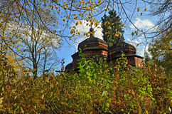 Church. Old wooden orthodox church among the trees Stock Images