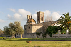 Church and Olive. Church with colored dome in Barumini, Sardinia royalty free stock image