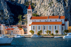 Church in Omis. With mountains on background in Croatia royalty free stock photo