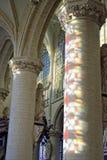 Church Onze-Lieve-Vrouw-over-de-Dijlekerk in Mechelen, Belgium. MECHELEN, BELGIUM-DECEMBER 29, 2013: Reflections from stained glass windows in interior of gothic Royalty Free Stock Images