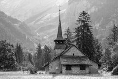 Church in the Open Field Near the Mountain Royalty Free Stock Photography