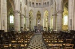 Church Orbais l`Abbaye. Orbais l`Abbaye, France - June 11, 2017: interior of the church of Orbais l`Abbaye with chairs, pilars and the altar, France Royalty Free Stock Images
