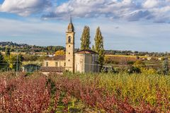 Church in autumn orchards. Church among orchards in the fall in the hills Royalty Free Stock Photos