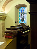 Church organ. Pipe organ keyboard with songbooks and mosaic as church background stock photo